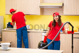 The cleaning professional contractors working at kitchen