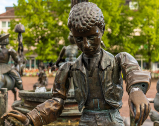 Sindelfingen, Baden Wurttemberg/Germany - May 11, 2019: Detail view on Monument of Market Place Fountain of Sindelfingen. Young Man.