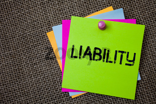 Handwriting text writing Liability. Concept meaning State of being legally responsible for something Responsibility Sticky cards board pinned muliple colours remember idea jute background.