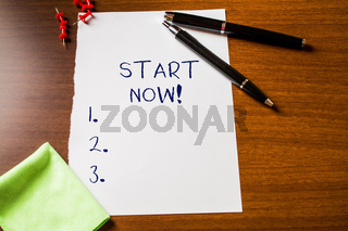 Text sign showing Start Now. Conceptual photo do not hesitate get working or doing stuff right away Blank stationary paper wooden table fountain pen cloth rag pins to fix.