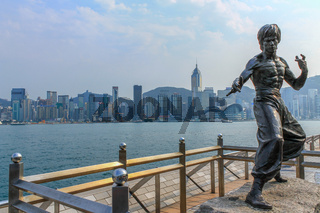 Bruce Lee Monument on Avenue of Stars near the promenade in front of the Skyline of Hongkong. Tsim Sha Tsui, Hong Kong, China.
