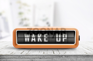Wake up alarm clock on a table in a bright room