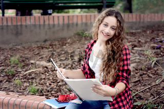 Young student girl with notepad