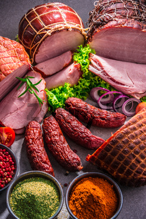 Composition with assorted meat products.