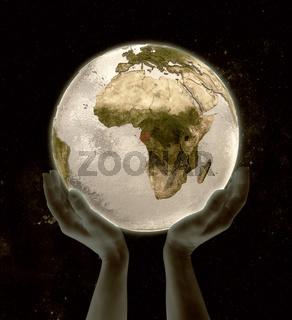 Gabon on globe win hands