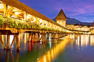 Lucerne wooden Chapel Bridge and tower colorful evening view