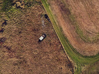 old abandoned and rusty vehicles in the autumn field from above