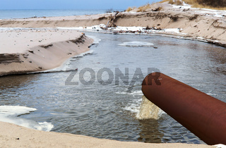 sewer pipe into the sea, the dirty drain waste water, environmental pollution