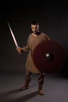 Handsome man in viking image full-length