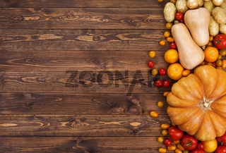 Harvest on wooden table background, top view