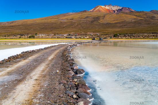 View of the dormant volcano Tunupa the village of Coqueza and the Uyuni Salt Flat