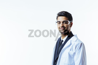 Portrait of a man in business suit, lab coat and protective glasses looking at camera