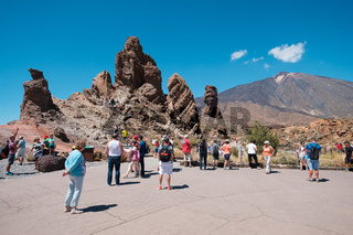 Tourists at Roque Cinchado rock on Mount Teide (Pico delTeide) National Park, Tenerife Spain