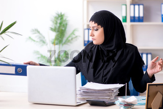Female employee bookkeeper in hijab working in the office