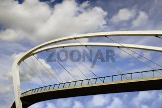 pedestrian bridge against the blue sky