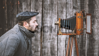 Concept - selfie. Selfie of old fashioned man on large format camera