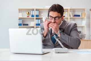 The businessman leaking confidential information over phone