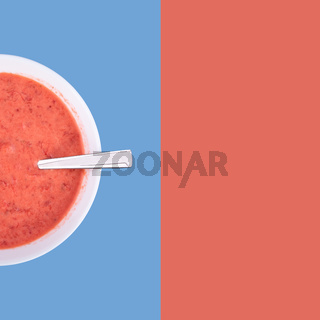 Fresh homemade yogurt, strawberries and sour cream mixed by using blender, top view, mixed colored background