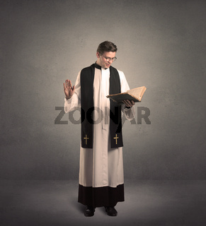 priest in giving his blessing