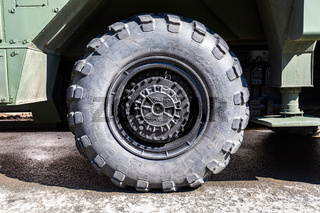 View of heavy truck army vehicle wheel with tire