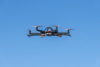 Professional drone flying with landing gear retracted