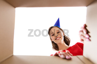 happy young woman looking into open birthday gift