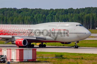 Airplane at the airport. The movement of the aircraft. . The plane goes to the airport. Russia, St. Petersburg Pulkovo Airport, June 19, 2019