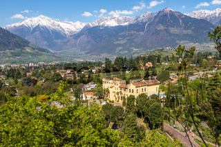 View on Castle Trauttmansdorff between a green Alps landscape and botanical garden of Meran. Merano, Province Bolzano, South Tyrol, Italy.