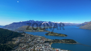 paraglider takes off from skyline in queenstown
