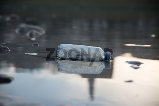 Environmental pollution: plastic bottle on the beach