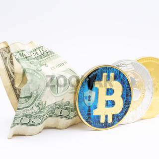 blurred crumpled dollar money and different bitcoin