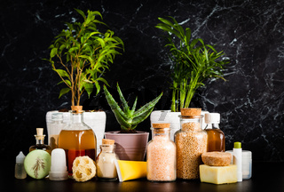 Natural homemade cosmetic in vintage bottles and plants