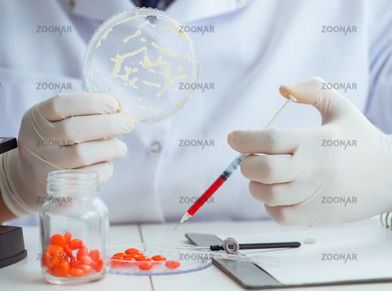 Doctor testing new drugs for medical purposes