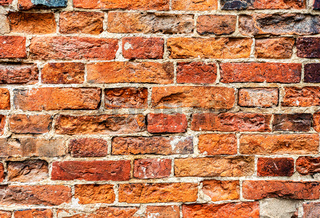 Rough red brick wall as background texture