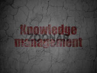 Education concept: Knowledge Management on grunge wall background