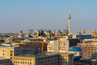A bird's-eye view of historic quarters in the center of Berlin in the evening sun.