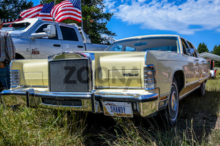 A large outdoor Rev Mountain Car and Bike Show in Lincoln, Montana