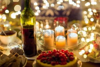 food, drinks and candles burning on table