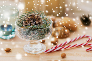 christmas fir decoration with cone in dessert bowl